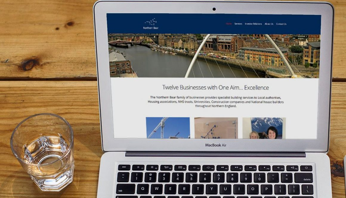 Northern Bear website on a laptop sat on a wooden desk